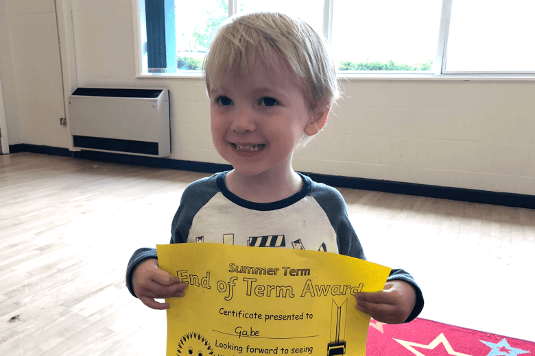 Gabe with his end of term certificate from preschool