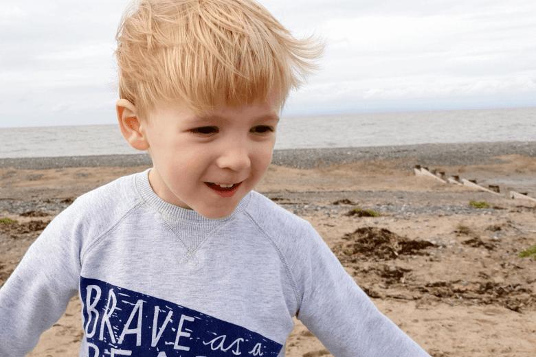 Gabe enjoying a windswept walk on the beach