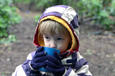 Gabe drinking hot chocolate at forest school