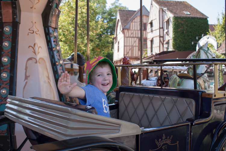 Gabe on a carousel in Provins, France