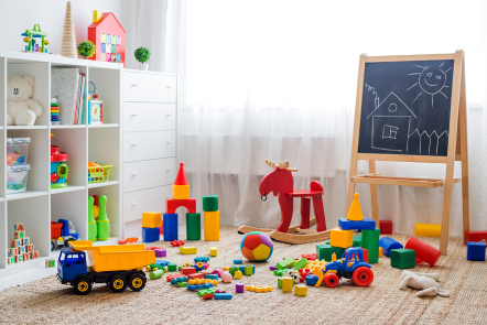 Playroom with cube storage, chalkboard easel and toys on the floor