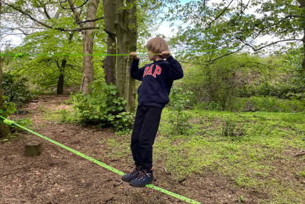 Toby on the slack line in the woods