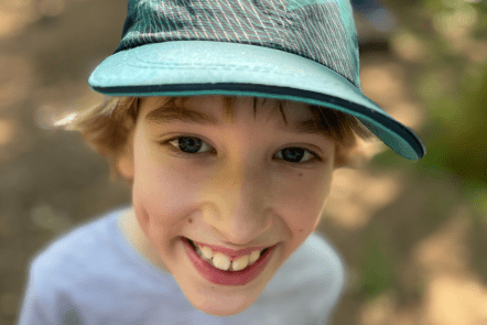 Close up of Toby wearing a green cap