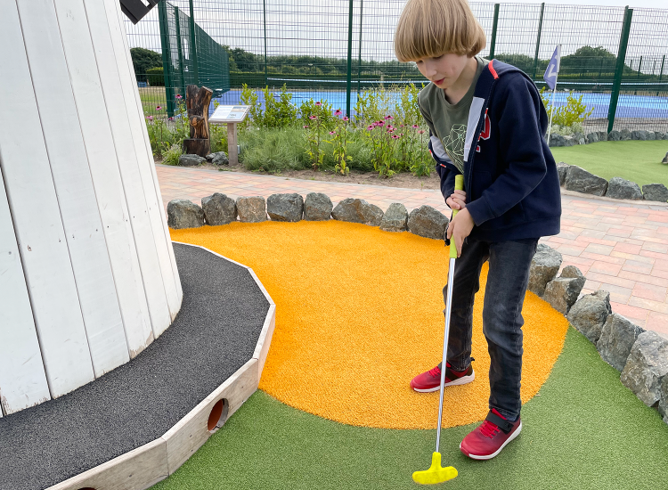 Toby playing crazy golf