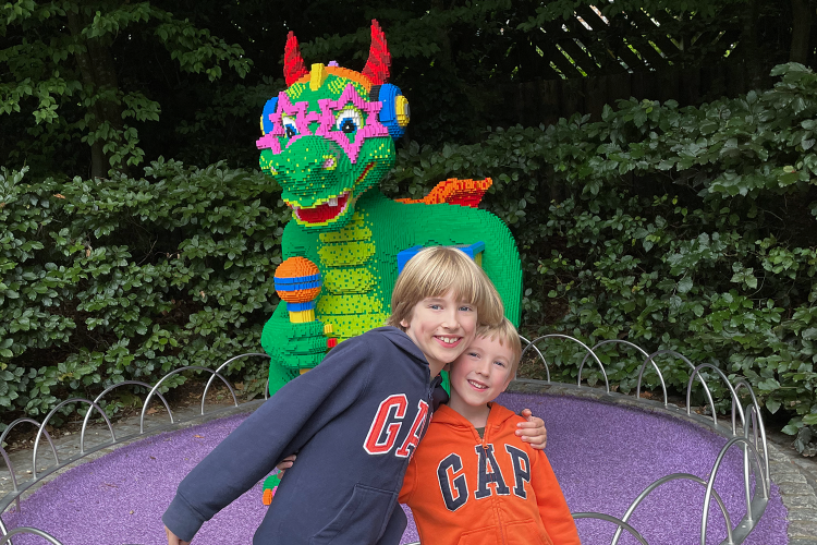 Toby and Gabe in front of a Lego dragon at Legoland Windsor