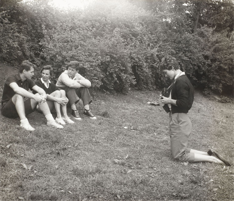 Robert F. Kennedy, Ethel Kennedy, JFK and Jackie Kennedy sit in the backyard of their Georgetown complex.
