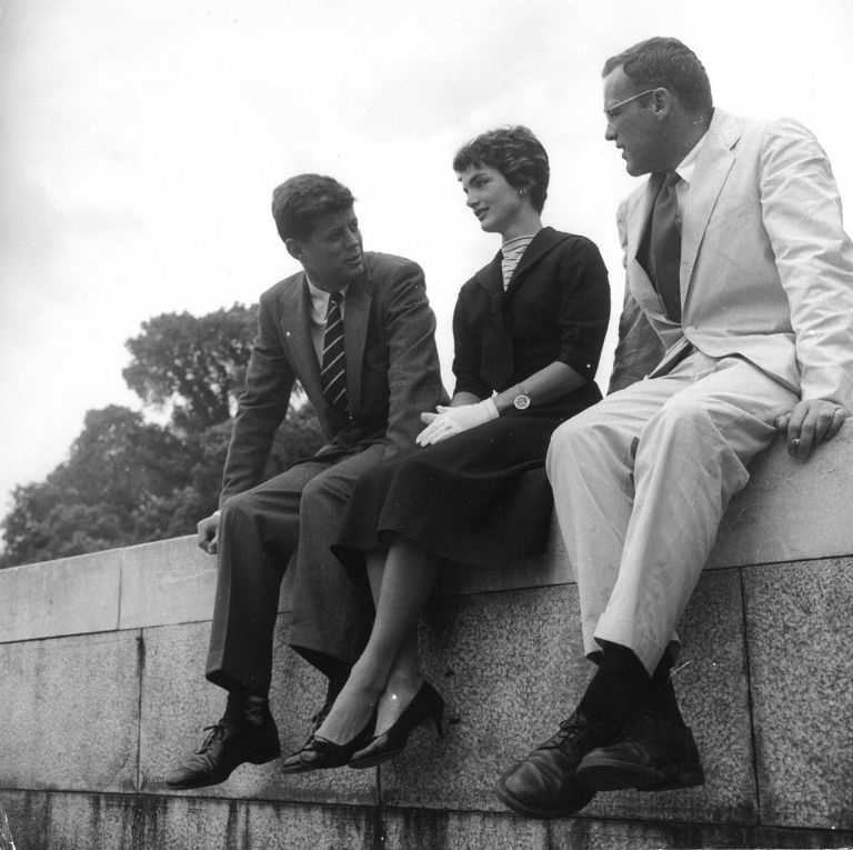 The couple sitting on a ledge at Capitol Hill with a colleague.