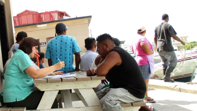 Claudia Stella Beltrán Turriago, economic consultant, interviewing fishers at Northern Fishermen's Cooperative in Belize City, Belize (Photo via CRFM)