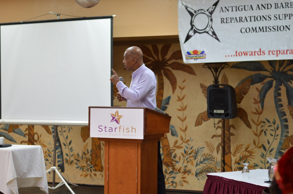 """Chairman of the CARICOM Reparations  Commission Professor Sir Hilary Beckles speaking at a symposium on """"Western Banking, Colonialism and Reparations.""""  at the Jolly Beach Hotel in Antigua and Barbuda"""