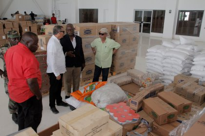 Minister of Citizenship Winston Felix, Preparedness and Response Manager of the Civil Defense Commission Major Sean Welcome and officials from the affected Islands with relief supplies. (Photo via Department of Public Information)