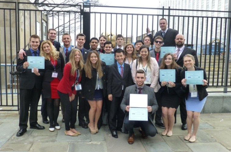 Model UN team poses with their winning certificates