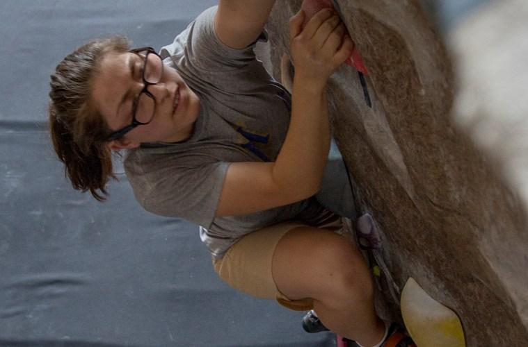 Student climbs the climbing wall at the WREC