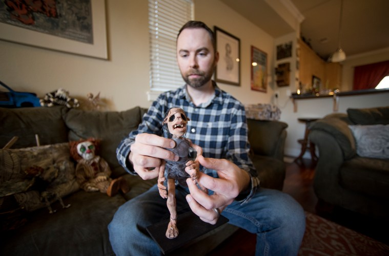 Josh Funk displays one of the models used in his short film, 3 Keys, at his home in Chico.