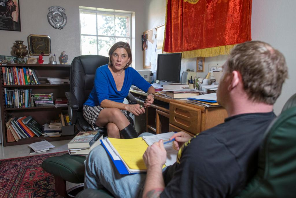 Professor Kate Transchel (left) advises student Justin Nielsen (right) in her office on Tuesday, March 3, 2015 in Chico, Calif. Professor Kate Transchel has been selected for the Outstanding Adviser Award. Since joining the Department of History in 1996, she has served as a club adviser, academic adviser and career mentor to students in myriad capacities. (Jason Halley/University Photographer)