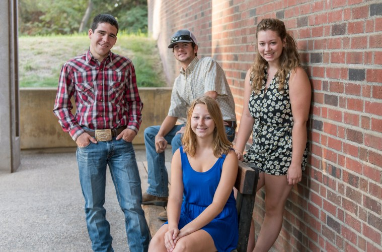 Photo of the four 2015 Bell Presidential Scholars, pictured together, smiling, in front of the College of Agriculture.