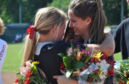 softball players embrace to show support