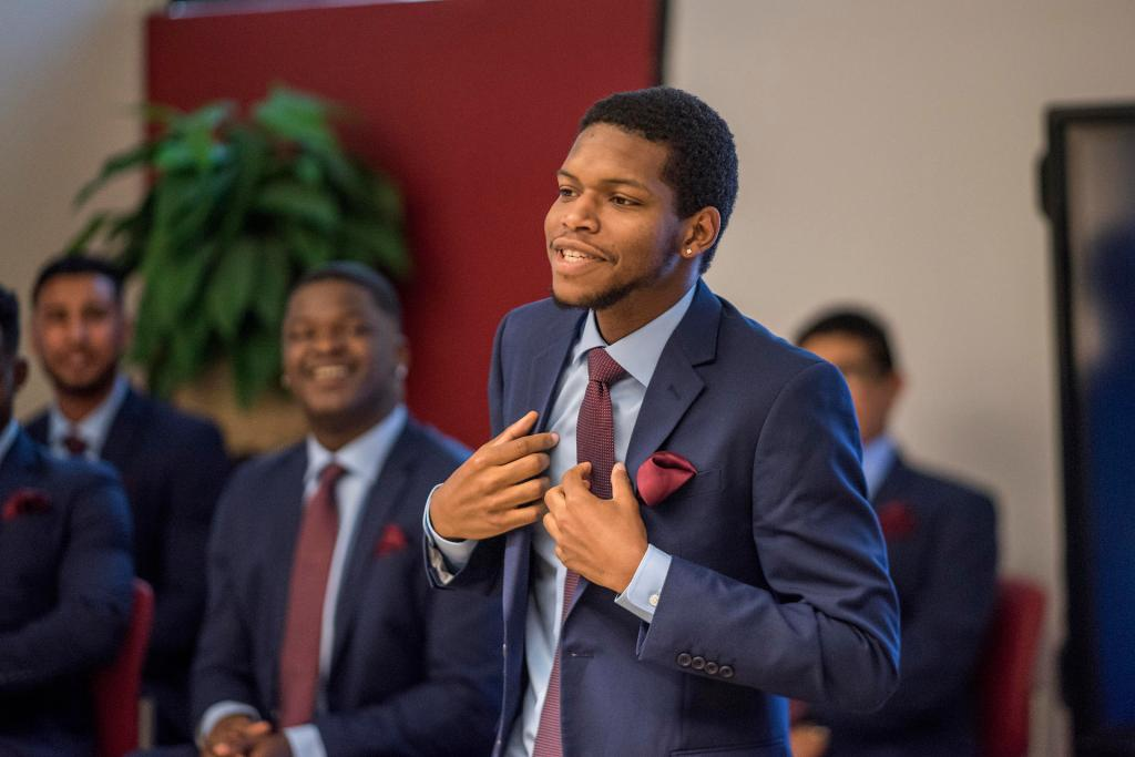 Kimani Davis II and other students are honored during program graduation of the first cohort of Men of Color