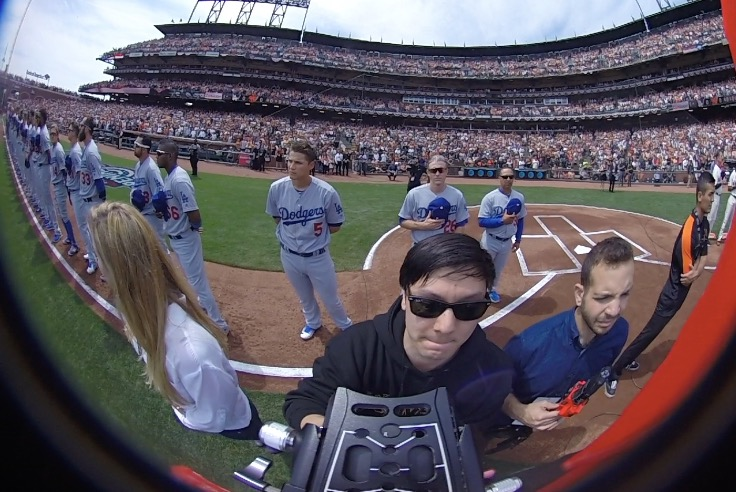 Barron filming a 360-degree video during the Giants' baseball opener in San Francisco.