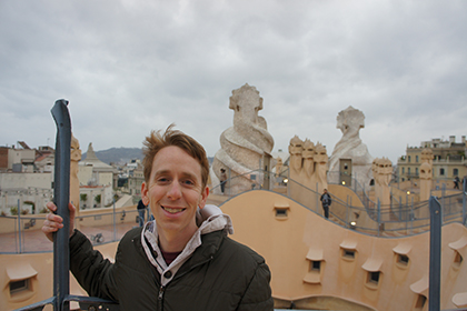 Matthew Stone standing with a view of Barcelona behind him.