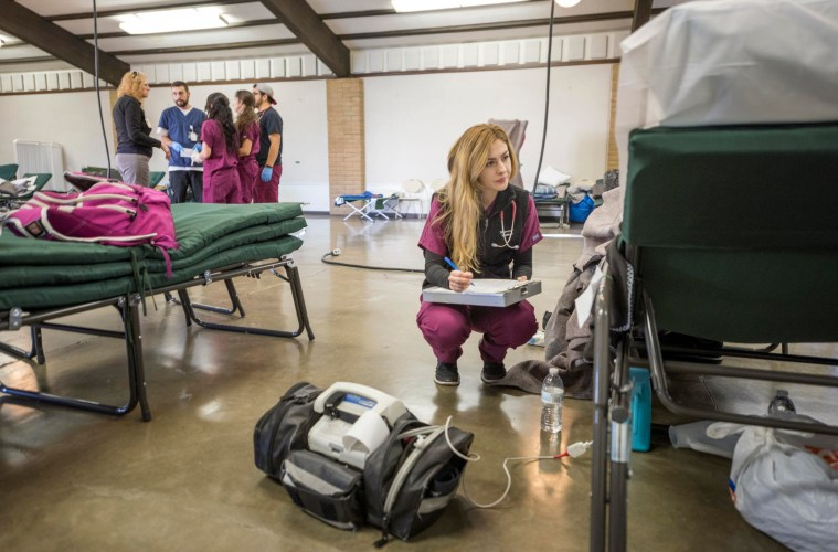 School of Nursing student Shannon Watson assists with patient care and health needs for evacuees of the Oroville Dam Spillway Incident at the Evacuation Center at the Silver Dollar Fairgrounds.