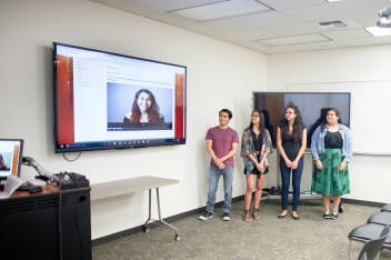 Students (from left to right) Christopher Barbosa, Breanna Barnard, Elizabeth Castillo, and Bianca Quilantan present their Listen to Change interviews in the Meriam Library. <br /> (Jessica Bartlett / Student Photographer)