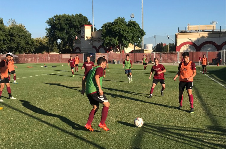 The Chico State men's soccer team trains last week at University Soccer Stadium. The entire team, as well as coaches, men's soccer alumni, and a few parents are traveling to Spain for an 11-day training and cultural immersion trip.