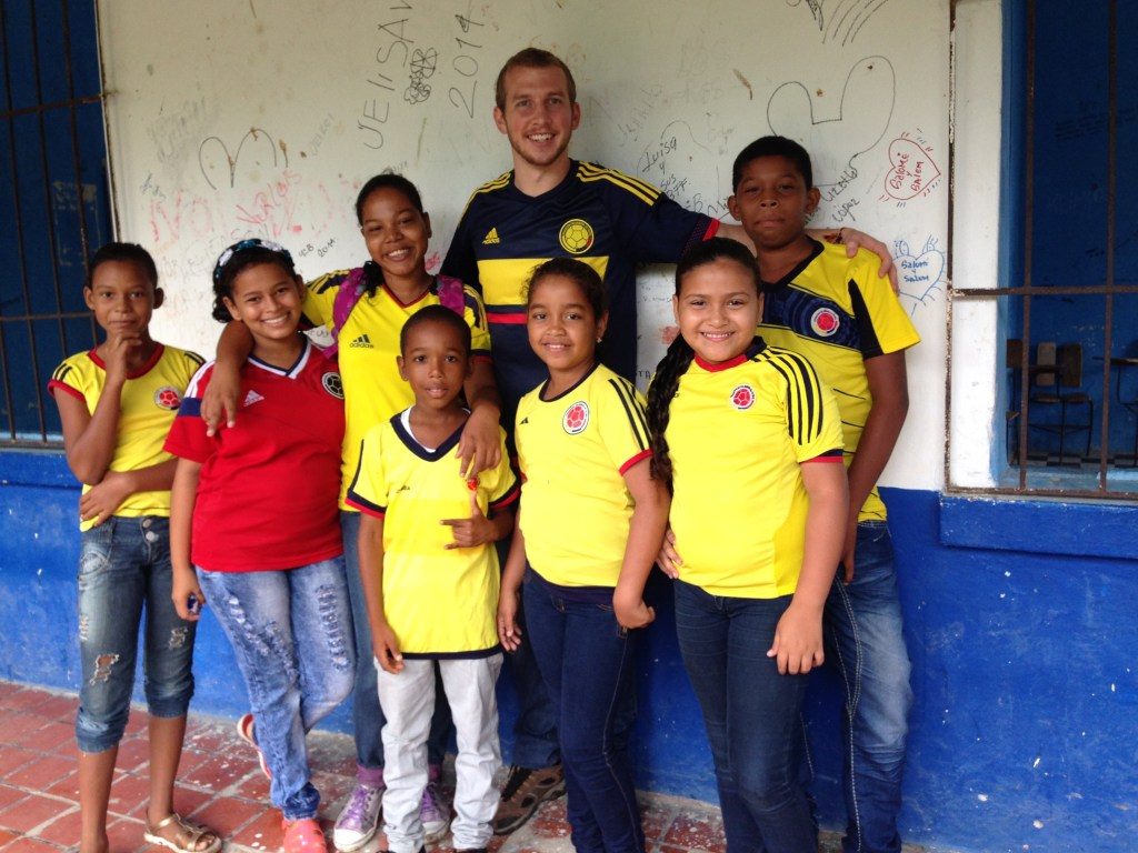 Johnson stands with a group of his young students in Colombia.