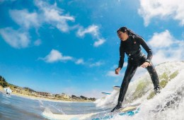 Olivia VanDamme loves surfing and spends time sharing that passion with younger surfers.