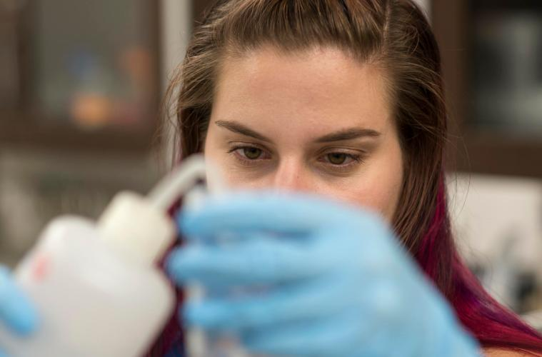 Liz Bianchini performs lab work