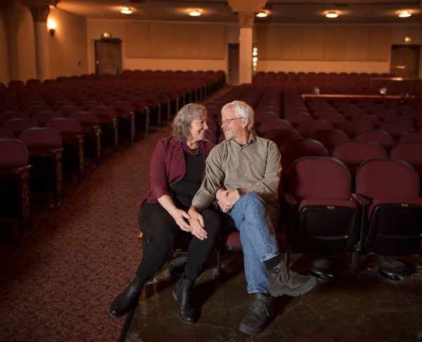 Daran and Dan Goodsell sit together in Laxson Auditorium and smile at each other