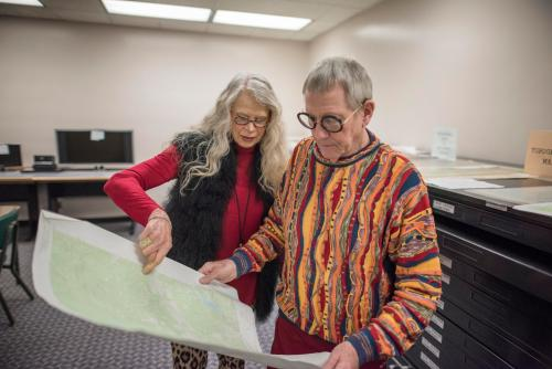 Librarian Joe Crotts (at right) and his wife Brenda examine a document in Meriam Library.