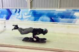 Brooke is mid-air as she jumps onto a skeleton sled