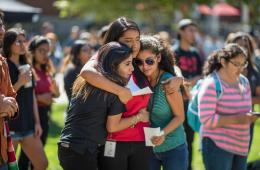Students embrace at a rally held on campus.