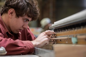 Daniel Michelson, is an HFA outstanding student leader award winner, and a double major in music and engineering, works on his DIY musical instrument creations in the Ayres Art Shop.