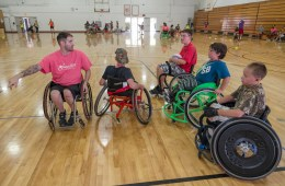 Devon Saul instructs his students in basketball at the annual Ability First Sports Camp, a sports and recreation instructional summer camps for children ages 8 to 17 with physical disabilities. Chico State plays host to many of the camp events and faculty and its Department of Recreation, Hospitality, and Parks Management provides staffing support for the camp.