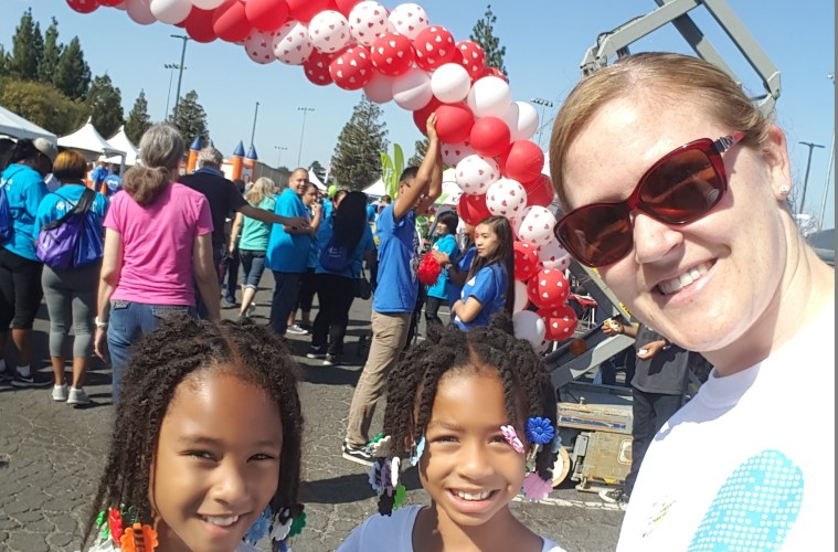 Casey takes a selfie with two young girls at the Heart Walk