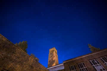 Stars shine above Trinity Hall.