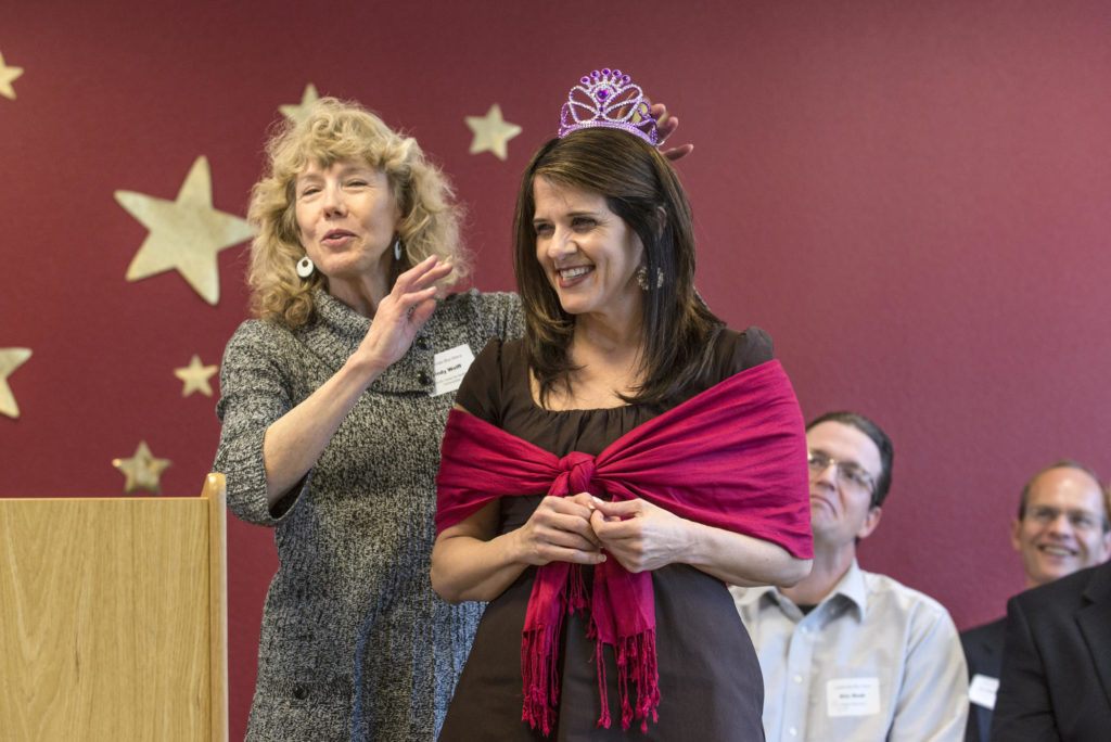 Cindy Wolff (left) honors Stephanie Bianco (right) at a February 2015 reception for the 2014-2015 Professional Achievement Honors, which highlight faculty who have exemplified the teacher-scholar model over the past three years.