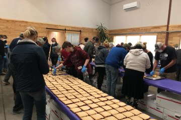 Volunteers working to assemble 1,200 sandwiches for firefighters, first responders, and shelter volunteers during the Camp Fire.