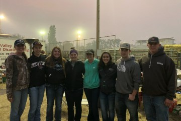 Livestock judging Team members stand in the smoky haze at the Butte County Fairgrounds.