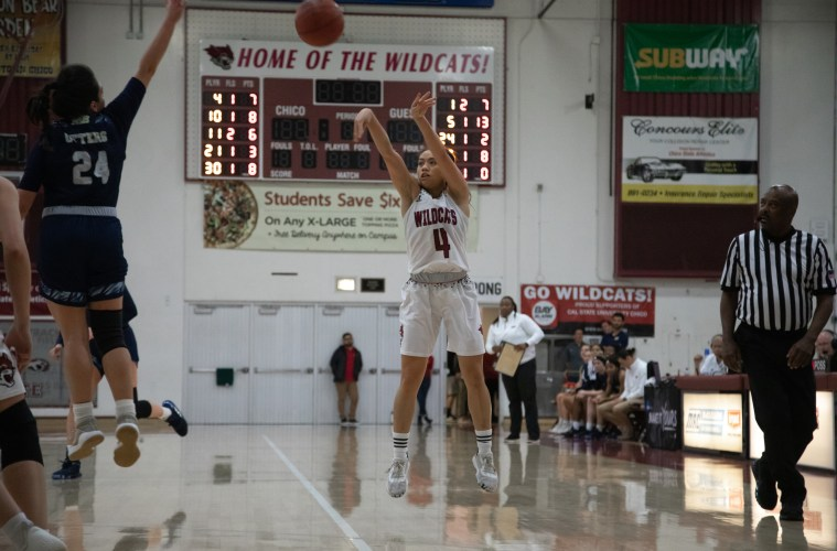 Maddy Wong shows picture-perfect follow-through as she releases a jump shot.