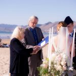 Wayne Edmiston and his wife Jacque officiating a wedding on Pismo Beach.
