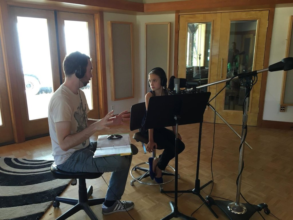 Josh Funk works with Mila Purvis on voice recording.