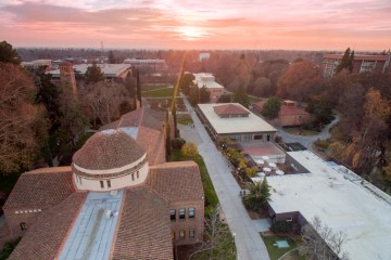 The sun sets over the Chico State campus on a winter afternoon.