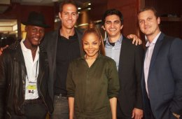 Janet Jackson and Barry Daffurn pose for a photo with three other men.