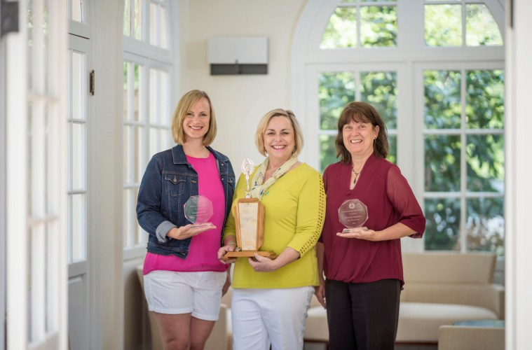 (Left to right) Brooke McCall, Kathleen Moroney, and Bev Langston pose with their awards.