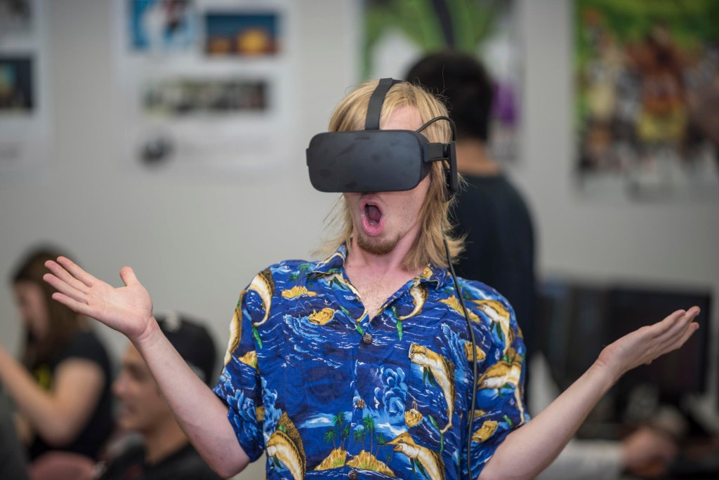 Student Truro Hawkins stands in awe while using the virtual reality technology.