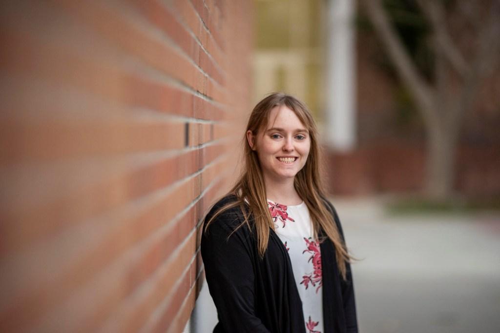 Caitlin Davis smiles in a portrait taken on campus