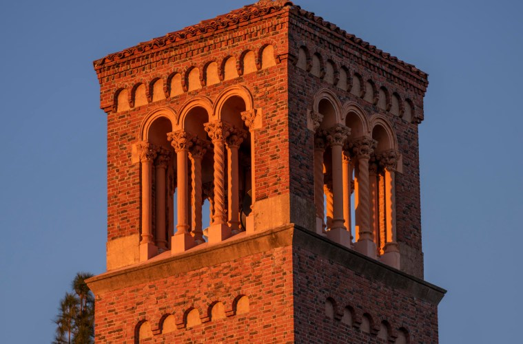 The sunset casts an orange glow on Trinity Tower.