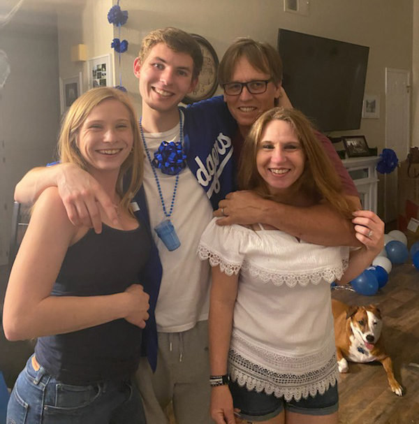 Kelly Shields and his family pose in their home.